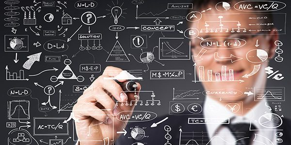 Successful and smart businessman writing imaginary text over gre