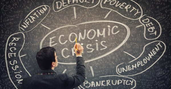 Businessman analyst drawing economic crisis scheme and related words as recession and default. Financial disaster global impact to the future economy. Recession, bankruptcy and unemployment concept.