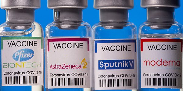 FILE PHOTO: Vials with Pfizer-BioNTech, AstraZeneca, Sputnik V, and Moderna coronavirus disease (COVID-19) vaccine labels are seen in this illustration picture taken March 19, 2021. REUTERS/Dado Ruvic/Illustration/File Photo