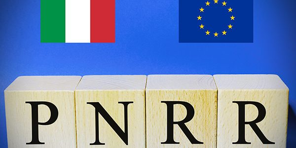 """Italian flag and european flag with the sign """"Pnrr"""", concept of"""