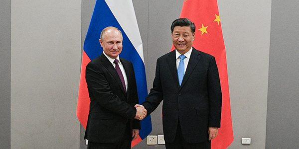 6072759 13.11.2019 Chinese President Xi Jinping, right, shakes hands with Russia's President Vladimir Putin during a meeting on the sidelines of the 11th BRICS Summit, in Brasilia, Brazil. The leaders of Brazil, Russia, India, China, and South Africa will discuss the current state and prospects of cooperation within BRICS, including issues related to economic, financial and cultural cooperation. Topical international matters, the situation around armament control and joint efforts to counter terrorism will also be discussed. Ramil Sitdikov / Sputnik (Photo by Ramil Sitdikov / Sputnik / Sputnik via AFP)
